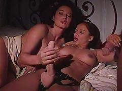 Voluptuous Brunettes Fuck Each Other With Strap-on