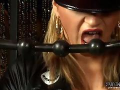 Eccentric slut in a leather costume fucked by three cocks