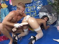 Lucy Bell gets oiled up and hammered hard in a doggystyle position
