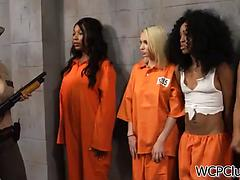 Mouthwatering ebony lesbians play a hot game in a female prison