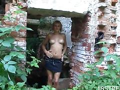 Tall solo model in a miniskirt strips and plays outdoors