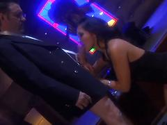 Sex appeal Asian brunette deepthroats a horny dude at a night club